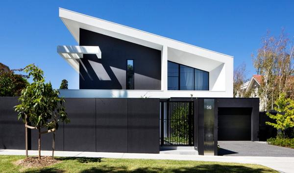 Красивый односкатный дом с геометрически четкими формами