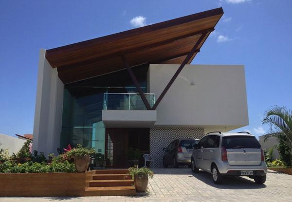 Сочетание односкатной и плоской крыши на доме