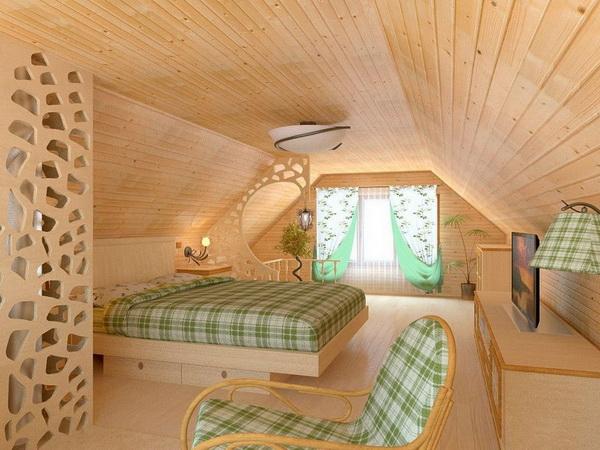 Кроме кровати, на мансарде нужно поставить кресла и столик